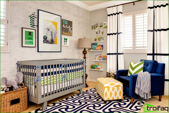 Bright well-lit children's room with decorative paintings on the crib