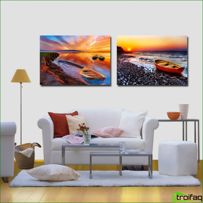 Colorful paintings on one motif in different designs in a bright living room