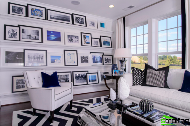 Monochrome interior diluted with blue accents in the paintings