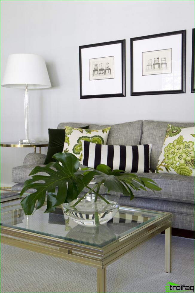 Luminoso salón en tonos monocromáticos con diseños gráficos enmarcados