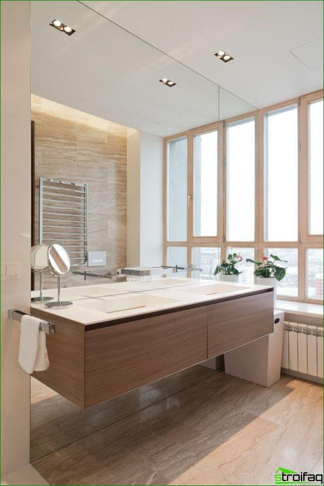 A large mirror can visually enlarge even a small bathroom
