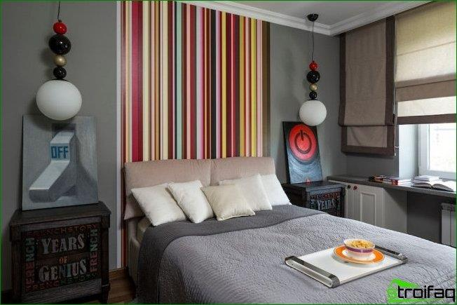 Vertical stripes from the wallpaper at the head of the bed work to increase the height of the ceiling