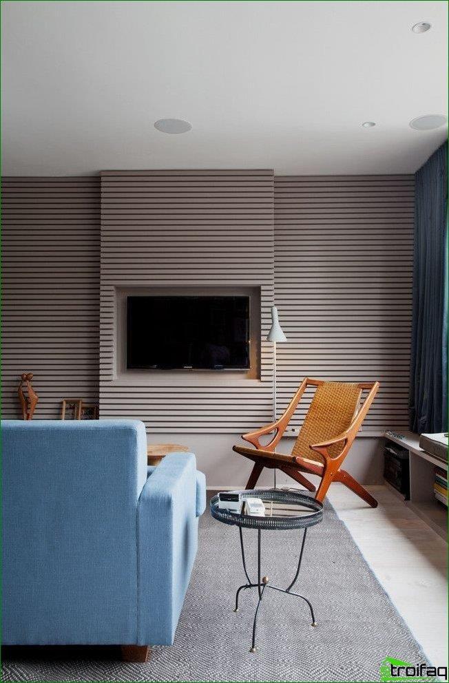 Modern living room interior with gray horizontal stripe wallpaper.