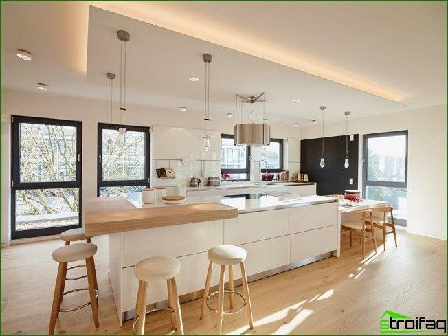 Bright, modern kitchen with false ceiling and ample lighting.
