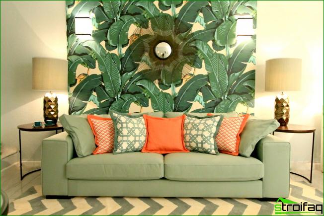 Gran iluminación en una sala de estar de color verde.