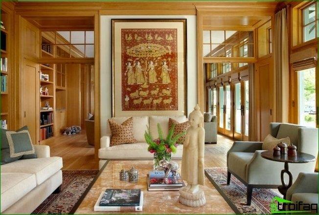 تمثال بوذا وتمثال صغير لصدر في الداخل على الطراز الهندي