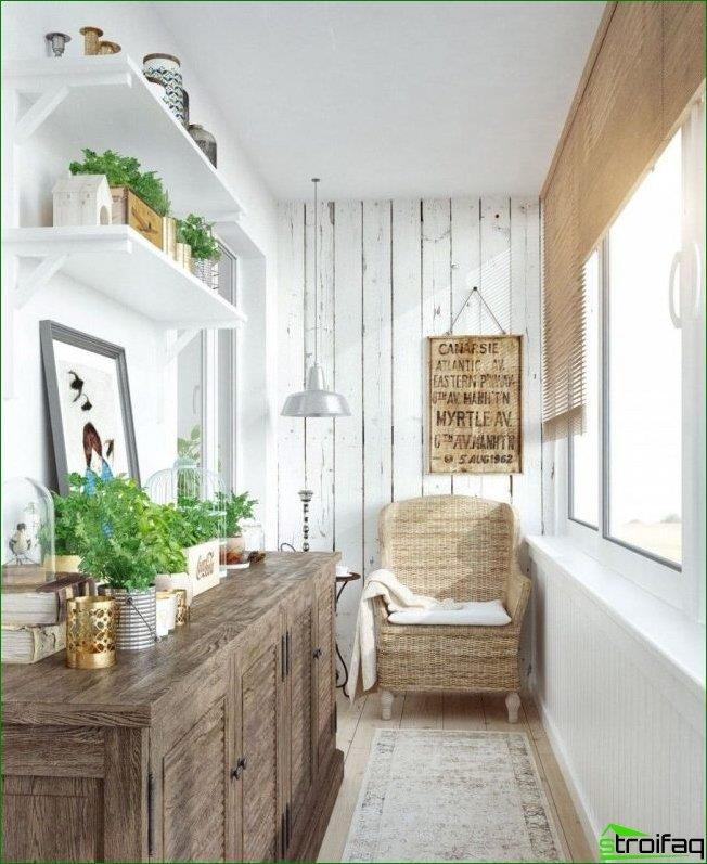 Bright walls, greenery on the shelves, wicker chair and wood in the hallway decoration in Provence style