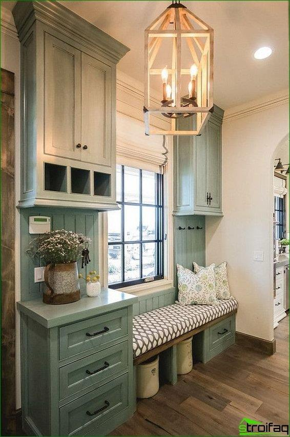 Provence hallway in olive color: bench with decorative pillows, hanging cupboards, shuhlyada and flower pot