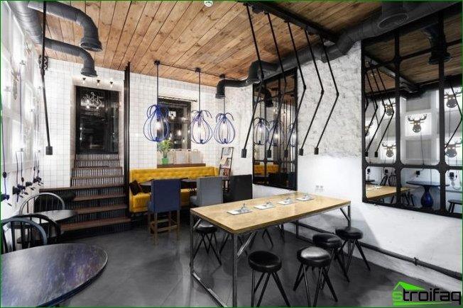 diseño de cafetería: los tubos de ventilación en el techo complementan la decoración de una cafetería moderna