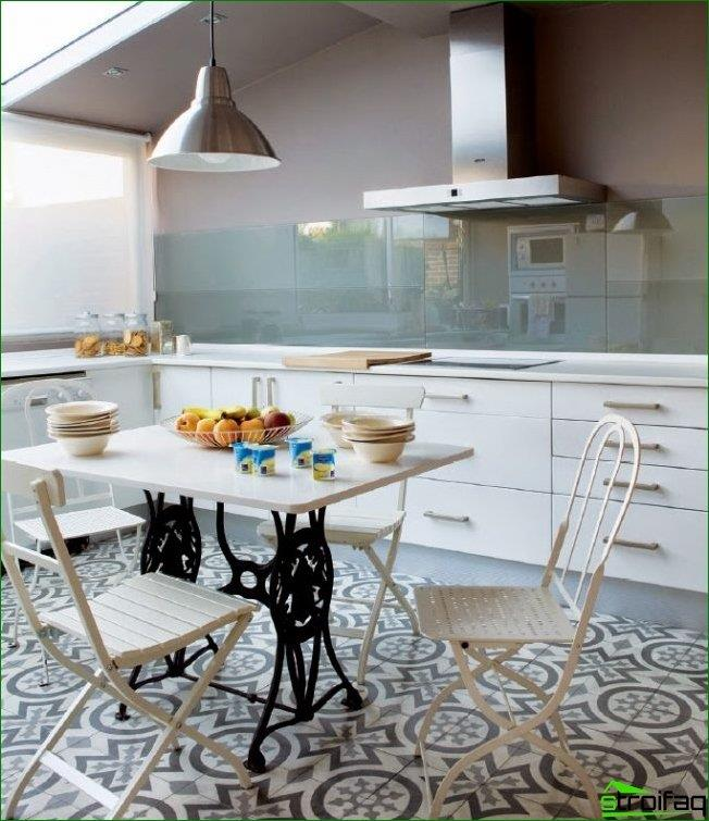 A sill-countertop in a bright kitchen made of MDF, which supports the general mood of the room