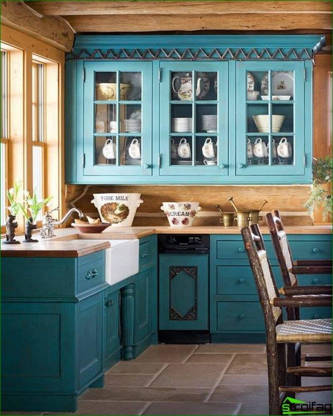 A cozy small kitchen in a private house in the country. Countertop sill - a great solution to save free space