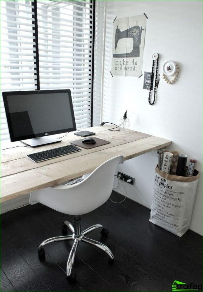 A simple window sill made of natural wood is perfect for a small workplace