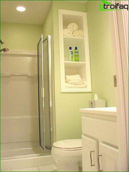White furniture in a small bathroom